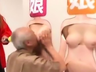 Hot Asian girls stand behind a body board and get groped by