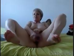 Blonde granny masturbates with dildo on cam