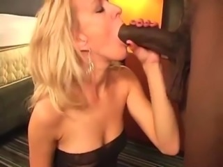 Blonde Milf sucking fucking big black cock in hotel room