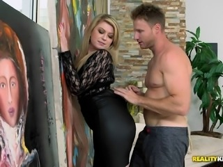 After giving head this MILF gets pounded by a younger guy