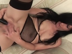 Alluring matured granny moaning while drilling her pussy using toy