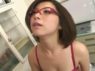 Petite Japanese nurse Kaoru Natsuki gets her hairy pussy licked
