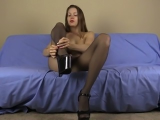 Perverted leggy and long haired brunette bitch in pantyhose plays with heels