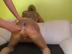 Ass fisting a pierced and tattoed mature slave slut