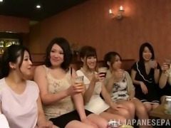At a club a group of Japanese girls has group sex with strange men