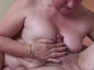 Horny grandma masturbates with big toys before getting bonked hardcore