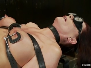Busty dark-haired mom gets her meaty cunt toyed in BDSM scene