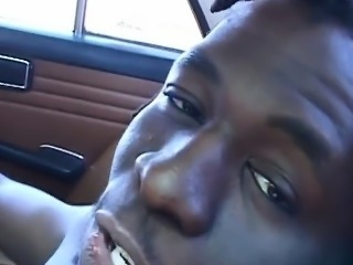 Ebony slave sucking black cock in car blowjob