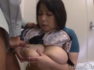Mature Asian cougar having her big tits squeezed before receiving cum on her...