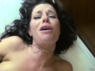 Big breasted brunette cougar fervorously fucks a huge cock on the bed