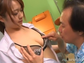 Arousing Japanese nurse in uniform with big tits giving a kinky blowjob...