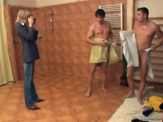 Horny milf Anette fucks hard with two guys in a shower