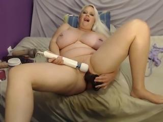 Masturbating and riding a huge dildo
