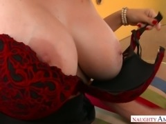 Dissolute mommy Charlee Chase gives blowjob and footjob to a hot guy