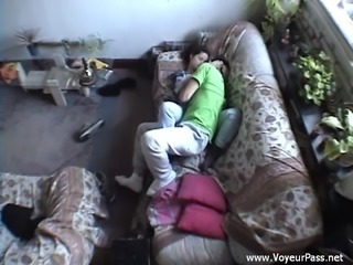 Dark-haired chick sucks and rides a cock in hidden cam clip