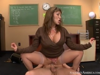 Wanton mommy with fake boobs fucks a horny student in the classroom