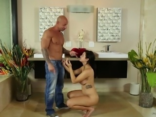 Dashing brunette babe with natural tits gets fucked doggy style in the shower before giving a massage