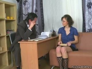 Attractive brunette chick in knee socks gives good blowjob to an older man