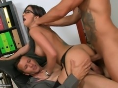 Brunette bitch in glasses pleasuring two dicks at once