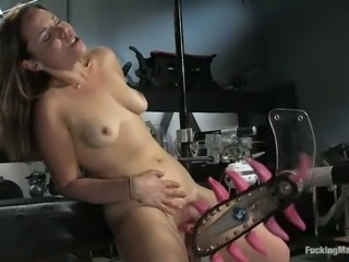 Two vacuum pipes suck her vagina lips, while she gets licked by a machine