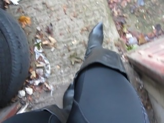 strutting around in my trashed leather thigh boots