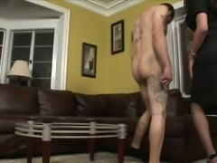 Black haired tranny in sexy fishnet stockings knows how to give good head