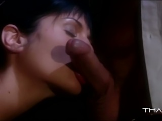 Zealous black haired harlot blows juicy penis ardently