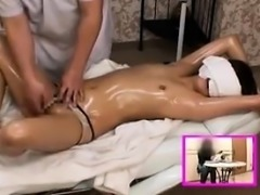 Petite Oriental babe lies on the massage table and is made