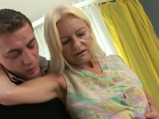 An old freaky lady happily lets this man undress her for sex
