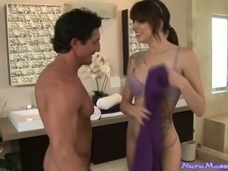 Beautiful tattooed brunette gives tugjob in the shower
