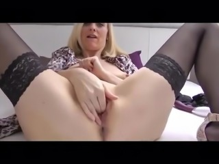Stunning mature in stockings and heels masturbates