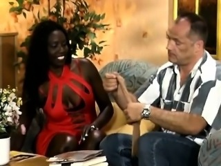 Ebony African curly interracial fucking on couch