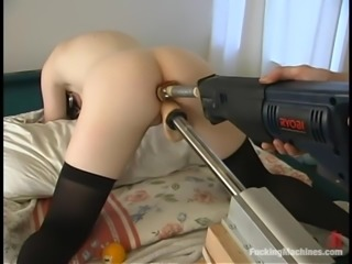 Dani gets her holes pounded at the same time by a sex machine