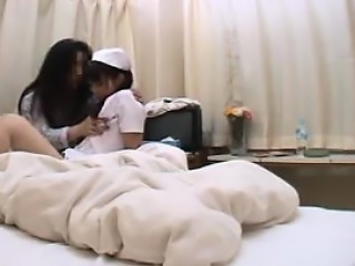 Adorable Oriental nurse exposes her wonderful ass and her s