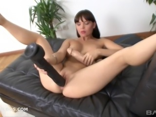 Solo brunette model drilling her gaping pussy with a monster dildo