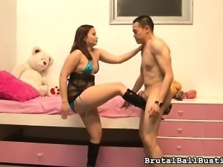 Provoking girl with lovely titties and a superb ass ballbusts her man