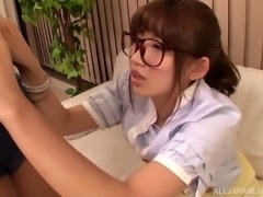 Redhead Japanese ten with glasses giving superb blowjob before getting...