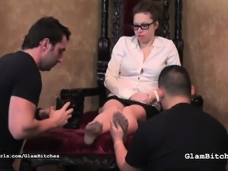 Prim brunette gets her feet rubbed then stands on him in heels