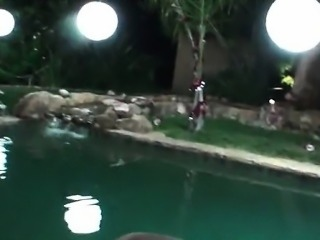 Chesty brunette fucked by the pool and jizzed