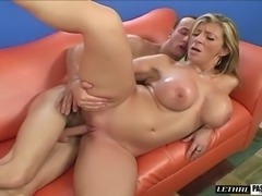 Pornstar with oiled big tits giving cock titjob then banged hardcore