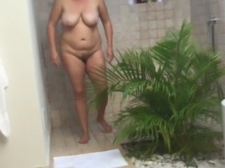 hidden cam catches unaware holiday MILF in shower