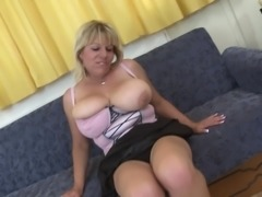Stacked blonde MILF Flavia squeezes her melons and fingers her cunt