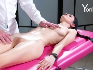 Chick on a massage table enjoys her new friend's long fingers