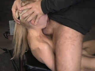 Cute blonde getting deepthroated by her captors in the basement