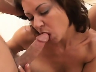 Horny mature woman cheats on her husband with two hung young studs