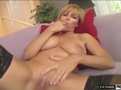 Blonde cougar in bra giving her horny guy superb titjob