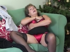 Classy mature granny stripteasing lovely in the living room
