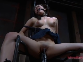 Woman in a black dress tied up during an erotic game