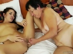 Mature lesbian granny eating out Carry Cherry's tasty pussy