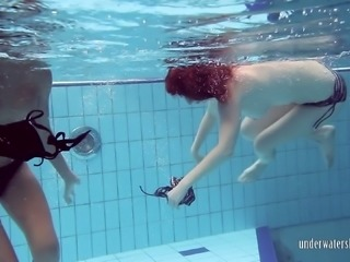 Two sexy teens swimming in the pool like sexy mermaids